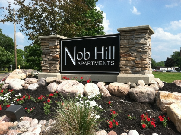 Architectural Signs :: Nob Hill Apartments:  This sign stands in front of the Nob Hill property entrance. It is a carved and painted HDU sign with stone pillars as a finish. :: Syracuse, NY Pittsburgh, PA