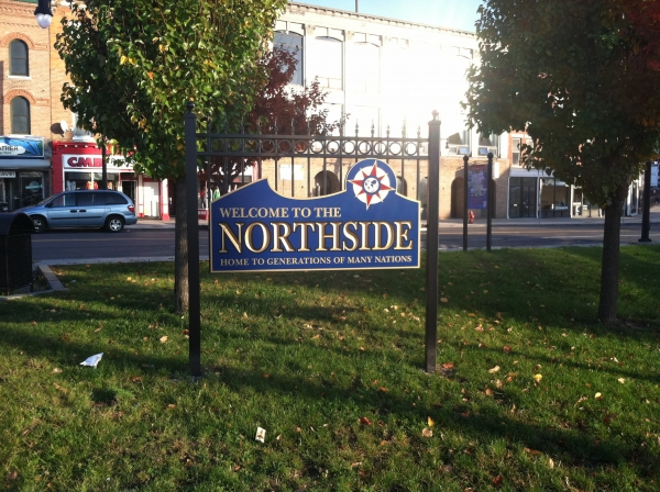 Northside :: This carved sign has a blue paint for the base and a gold paint finish for the letters. :: Syracuse, NY